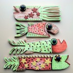 Little Fysh, acrylic and attachments on cut / recycled picket fences